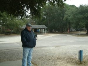 "Jim outside the ""facilities"" at the campground"