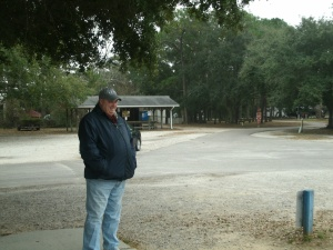 """Jim outside the """"facilities"""" at the campground"""
