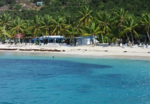 The building is Soggy Dollar Bar, but look at the gorgeous shades of blue in the water!