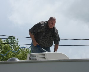 Weekend Warrior Jim Scrubbing the RV Roof