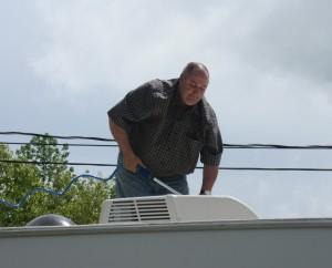 Weekend Warrior Jim Scrubbing the RV Roof