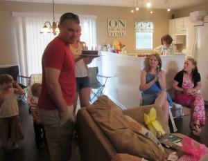 Lydia holding birthday cake - also pictured L to R: Presley, Sammy, Brett, Mary, Gretchen, and Casey