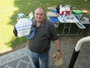 Jim oaded down with clean, dry clothes and a towel