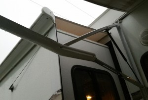 Bent awning arm