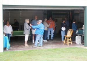 Airstream Rally participants visiting in the meeting area (Ms. Helen is the lady to the left)