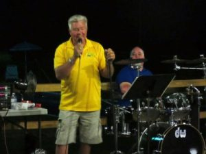Larry Frisbie singing at the Memorial Day event
