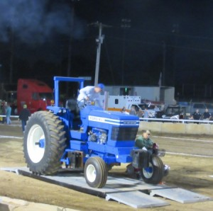 Though driven on the scales by a man, a woman drove this tractor to victory in her class