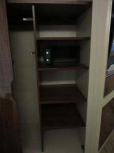 Shelves next to the closet
