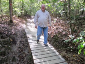 Jim crossing one of the several mini bridges