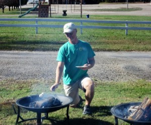 Campground manager Bill is making s'mores.