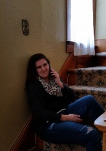"Clarissa, the youngest, hanging out on the steps and on the phone, making her usual ""face"" for pics"