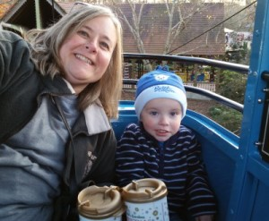 Grandma and Sammy, with hot chocolate in hand, riding the sky lift