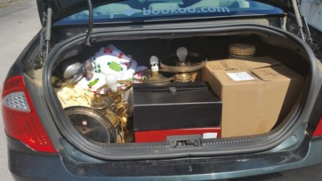 Angela loaded the fragile items in her car.