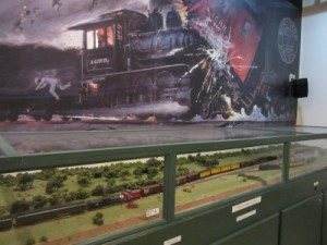 Diorama of the track situation and the wreck and a painting above depicting the accident