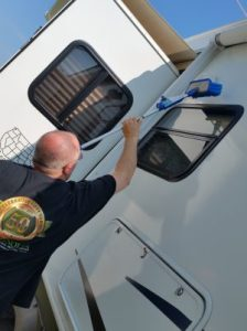 Jim Washing the Camper