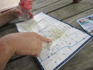 Plotting our driving route using the map we were given.