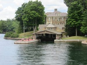 One of the many lovely homes with boat house on the river