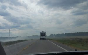 Jim towing the RV through smoke ahead of me