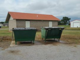 Dumpsters (for the 3 businesses) w/ restrooms behind