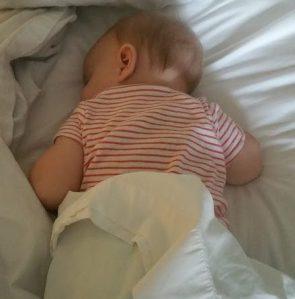 Precious girl asleep in hotel