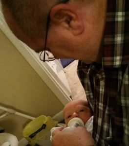 Papa Dude feeding Alex