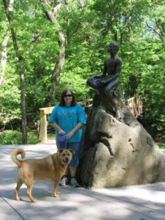Angela & Chewie beside statue of Carver as a child