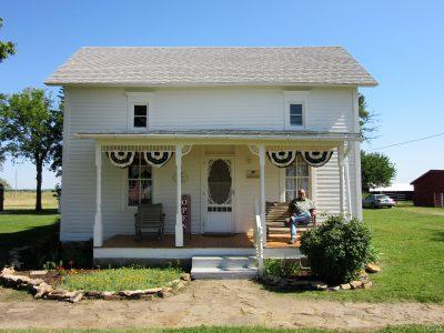 House - gift shop inside; Jim on porch
