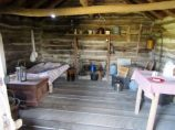 Inside replica of Ingall's log cabin