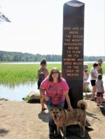 Angela & Chewie at Headwaters sign