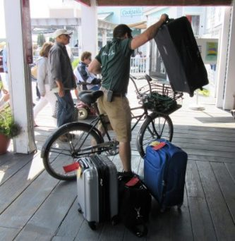 Bicycle porter stacking his bike