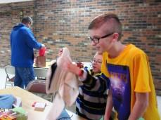 Dylan & Noah looking at gifts