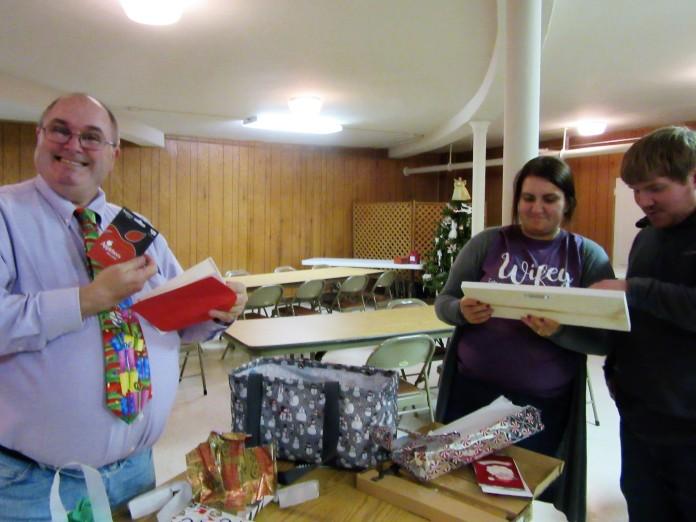 Jim, Clarissa & Josh opening gifts