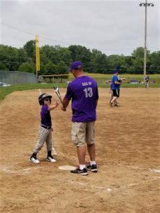 Coach Dad gives batting instruction