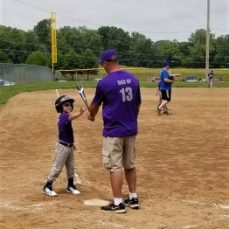Coach Dad gives batting instruction