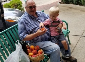 "Checking out peaches from the Farmers"" Market"