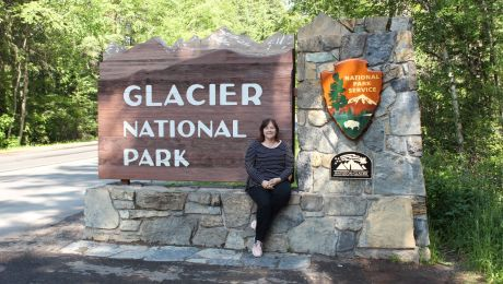 Angela at the entrance to Glacier National Park